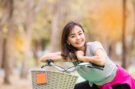 Attractive happy mature woman ride bicycle in  countryside , lifestyle concept ,  vintage tone