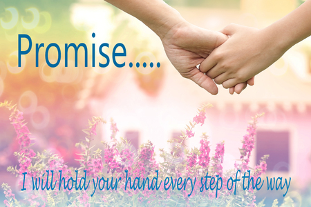 Inspirational quote by unknown source on vintage background , lover hands holding together on de-focused of pink flowers in garden with  little vintage houses , family , help and support concept