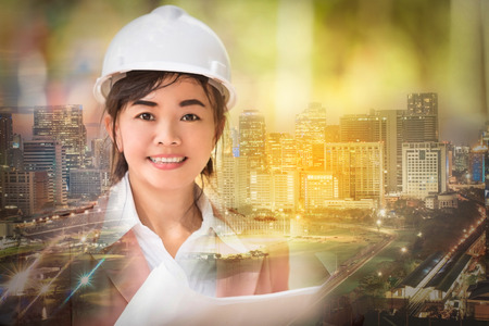 double exposure and soft focused , executive Asian engineer woman and cityscape scene , business environment engineer concept