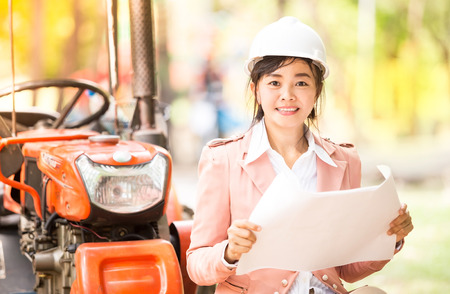 executive Asian engineer woman checking construction site , business environment engineer concept