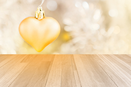 little golden heart decorated on white background and ivory panel texture Stock Photo