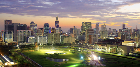 defocused and panorama , background of Bangkok cityscape with golf course in nighttime