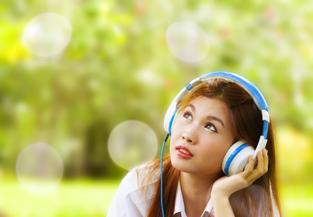 close up portrait of Asian woman relax style with song and headphone