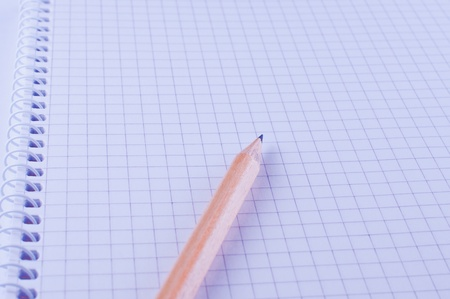 Pencil on open white paper notebook Stock Photo - 11645643
