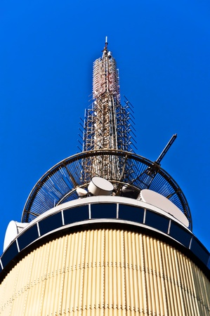 Telecom tower with microwave links and cellular network antennas on blue sky Oslo Norway Stock Photo - 11841757