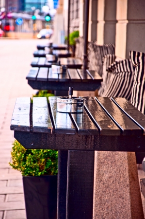 Typical generic outdoor cafe seating  Stockholm Sweden with tables and chairs on the sidewalk Stock Photo - 11829346
