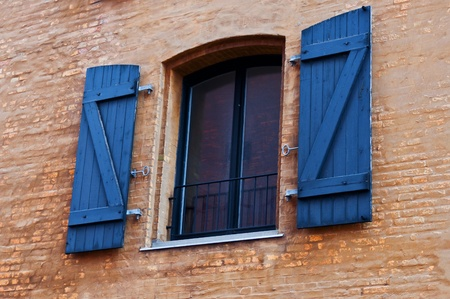 Window with shutters on brick Background photo
