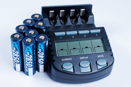 electronic energizer: Battery charger with battery on wite background Stock Photo