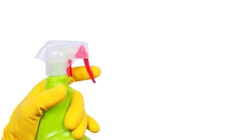 Hand in yellow glove with green sprayer