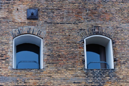 Two  windows on brick background photo
