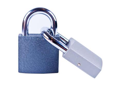 Two padlocks on white background isolated close up photo