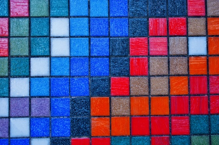 Abstract colorful tiles wall background close up photo
