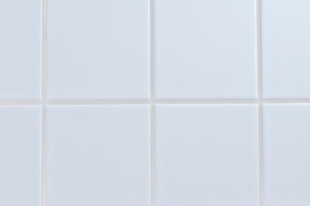 Wit porseleinen tegel muur close-up achtergrond
