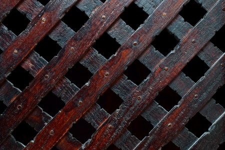 Wooden plank cross bacground with nails dark furniture Stock Photo - 12196679