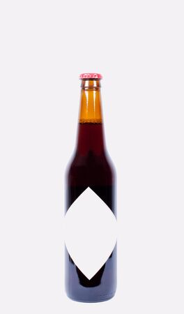 dewed: Bottle of beer on white background isolated