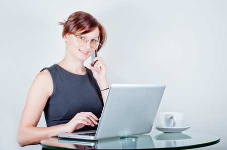 Smiling young business woman speaking on mobile phone Stock Photo - 12515264
