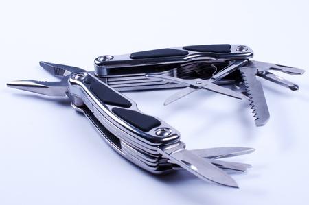 multipurpose: Fully unfolded multy tool on white background