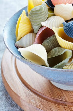 Pasta in bowl on a coarse cloth photo