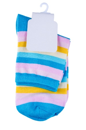 Multicolored striped socks with tag isolated photo