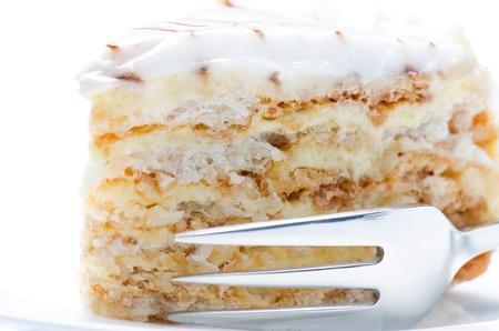 Slice of almond cake close up Stock Photo