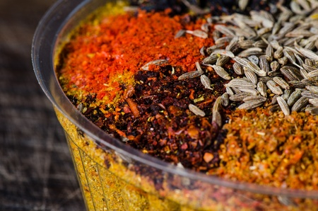 Close up Georgia spice mix on dark wooden table.