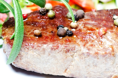 Beef steak with pepper close up photo