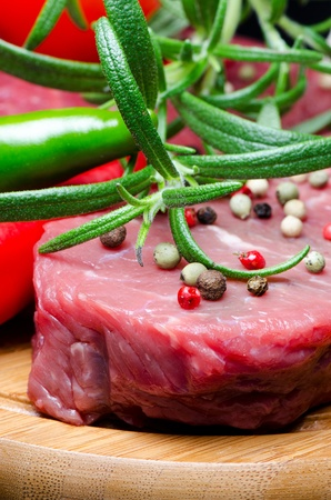 Raw beef steak on wooden board close up Stock Photo - 13724560