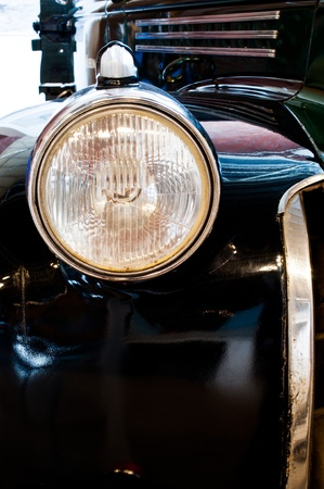 Close up front light of retro car photo