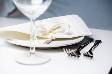 dof: Tables set for meal close up