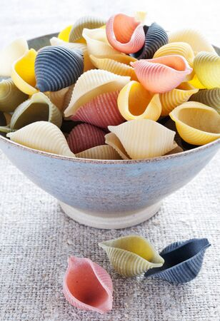 Italian multi colored pasta in bowl photo