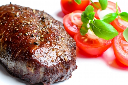 beef tenderloin: Steak with tomatoes close up Stock Photo