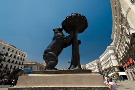 Symbol of Madrid - statue of Bear and strawberry tree, Puerta del Sol, Spain Editorial