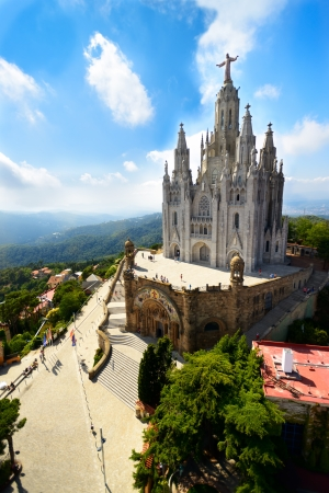 tibidabo: Tibidabo church on mountain in Barcelona with christ statue overviewing the city Editorial