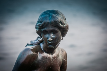 COPENHAGEN, DENMARK - JUNE 11: Mermaid statue in Copenhagen, Denmark, which is tourist attraction is build in 1913, based on the fairy tale of the same name by Hans Christian Andersen pictured on June 11, 2011 Editorial