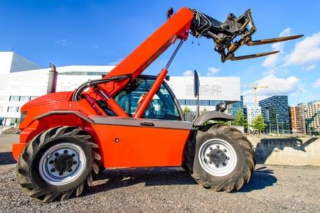 skid steer: skid steer loader at construction area near Oslo Opera House