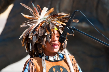 OSLO, NORWAY - JULY 18: Native American Indian tribal group play music, sing and dance to entertain shoppers in Oslo, Norway on July 18 2010 Stock Photo - 14915148