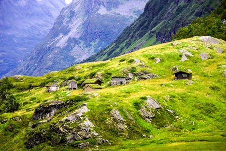 Cabins at remote location in mountains on a cliff, Norway photo