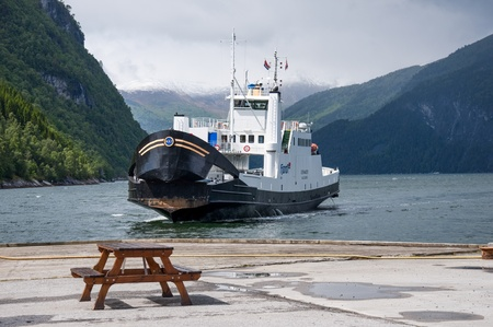 ferryboat: EIDSDAL, NORWAY - JUNE 19: One of 75 ships belonging to Fjord1 Nordvestlandske a Norwegian transport conglomerate on June 19, 2010 in Eidsdal, Norway