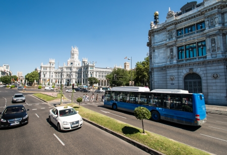 buss: MADRID - JULY 11:  Plaza de Cibeles in Madrid, Spain on July 11, 2012, with the Communications Palace in the background. It is the kilometer zero of Spain.