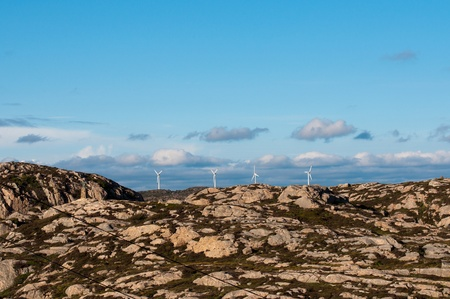 Four wind mills in mountains Stock Photo - 15120541