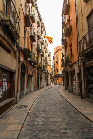 jewish houses: GIRONA, SPAIN - JULY 15: Street in the jewish quarter of Girona, Spain on July 15, 2012. The history of the Jewish community of Girona ended in 1492, when the Catholic Kings expelled all the Jews from Catalonia.