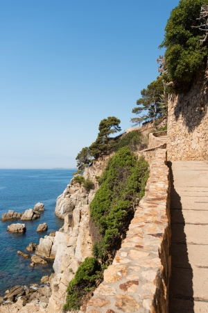 A wall and stairs high above the mediterranean sea photo