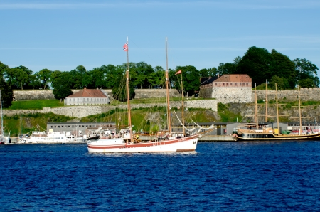 Boat with Akershus Fortress on background, Oslo, Norway Stock Photo - 16532953