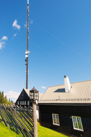 advisement: Communication tower from a rural landscape