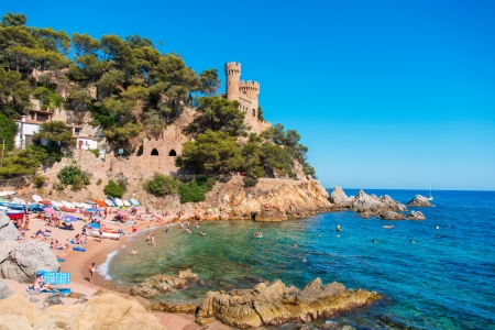 kilometres: LLORET DE MAR, SPAIN - JULY 18: Lloret de Mar is a Mediterranean coastal town in Catalonia and one of the most popular holiday resorts on the Costa Brava on July 18, 2012. It is 40 kilometres from Girona and 75 kilometers from Barcelona and therefore easi Editorial