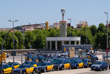 governed: BARCELONA - JULY 19: Barcelona has a metered taxi fleet governed by the Institut Metropolita del Taxi (Metropolitan Taxi Institute), composed of more than 10,000 cars on July 19, 2012. With their black and yellow livery, Barcelonas taxis are easily spott
