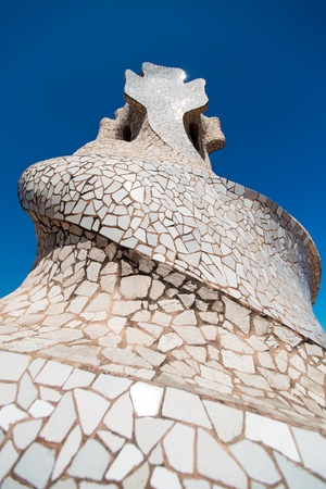 BARCELONA - JULY 19: Chimneys covered with ceramic fragments that look like helmets at La Pedrera (Casa Mila) on July 19, 2011 in Barcelona, Spain. Casa Mila was built in 1910 by Antoni Gaudi.