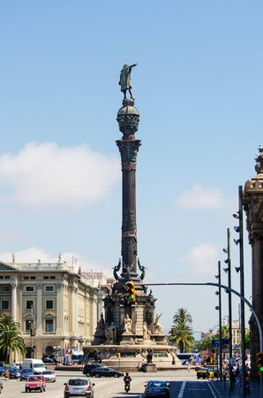 columb: BARCELONA, SPAIN - JULY 19  Tourists walking near Columbus monument in July 19, 2012 in Barcelona, Spain  Columbus Monument is 60 m  It is located at finish La Rambla and built in 1888 Editorial