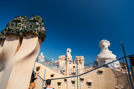 BARCELONA, SPAIN - JULY 19: Antoni Gaudis work at the roof of Casa Mila on July 19, 2012 in Barcelona, Spain. Popularly known as La Pedrera, this modernist house was built between 1906 and 1910.