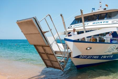 pleasure craft: LLORET DE MAR, SPAIN - JULY 20: Dofi Jet Tres mooring beach in Lloret de Mar on July 20, 2012. Its 25,27 meters long, tonnage 137,96 GT and in service from 2001.